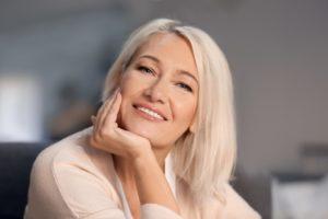 older woman wearing dentures in Tysons Corner