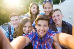 group of teenagers taking a selfie together